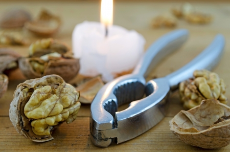Retro nut-cracker with candle photo