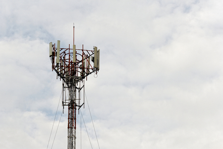 Mobile phone communication tower transmission signal with Cloud sky background