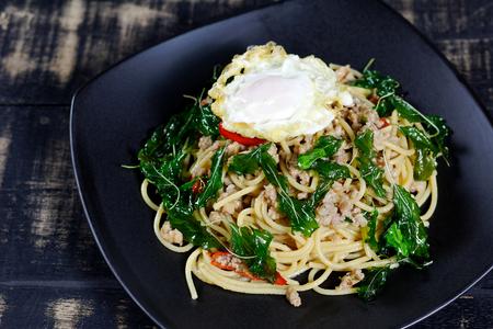Spaghetti with minced pork basil with fried eggs (Pad Kra Pao kai dao)