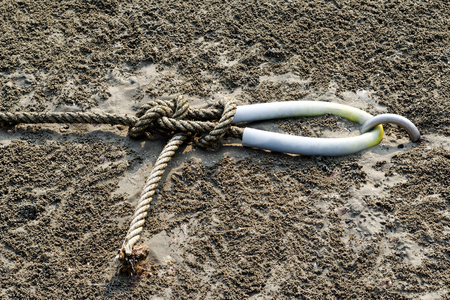 Rope knot with stainless anchor Buried in the sand beach