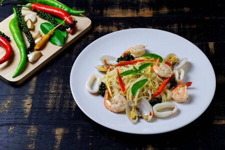 Stir fried pasta with Prawns squid and Short Necked Clam.Thai style food