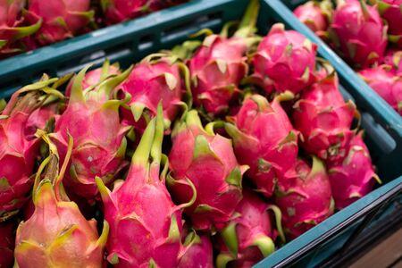 ripe dragon fruit or Pitaya in bucket Sell on local market