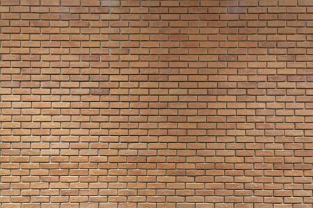 Texture of brown color decorative brick wall background