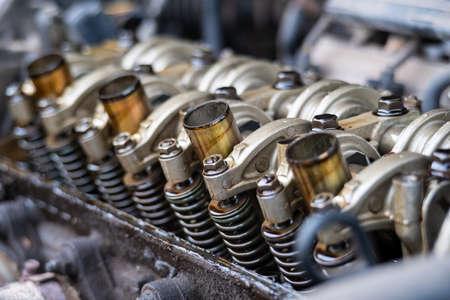 Close up Arm valve rocker of Single Over Head Camshaft engine.Car maintenance Checking and adjusting valves clearance. Reklamní fotografie
