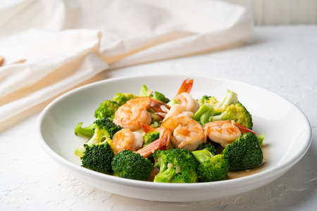 Stir Fried Broccoli with Shrimp in white plate