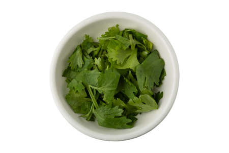 Chop coriander in a white bowl isolated on white background 版權商用圖片