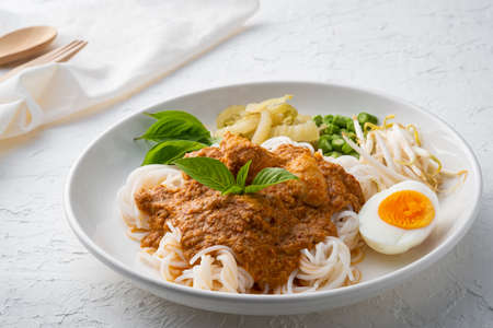 Rice noodles in fish curry sauce with meatball and vegetable (Kanom Jeen Nam Ya)