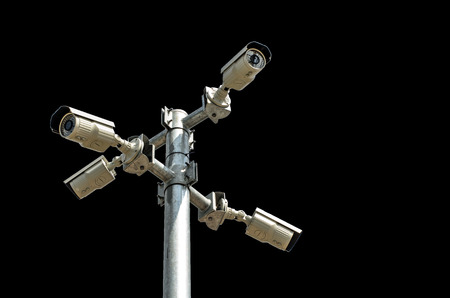 under surveillance: Four Security camera isolated on black background Stock Photo