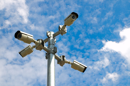 under surveillance: Four Security camera with blue sky
