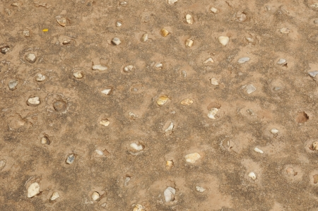 Brown pebble concrete ground photo