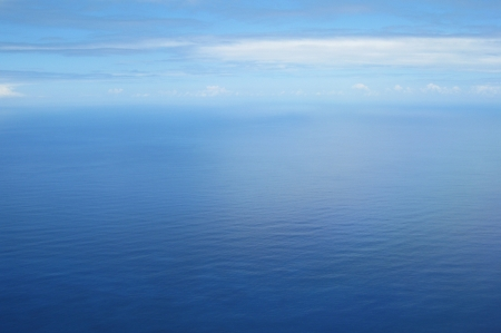 colorful water surface: Blue sea and sky