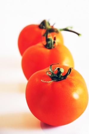 Three tomatoes Stock Photo - 14399728