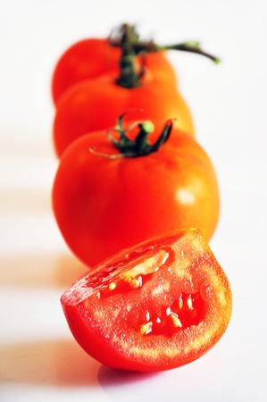 Red Tomatoes isolated on white background Stock Photo - 14399740