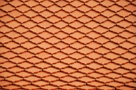 Ancient thai style roof made from clay tiles photo