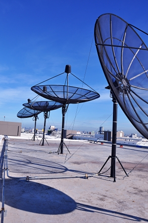 new media: Satellite dishes on the deck