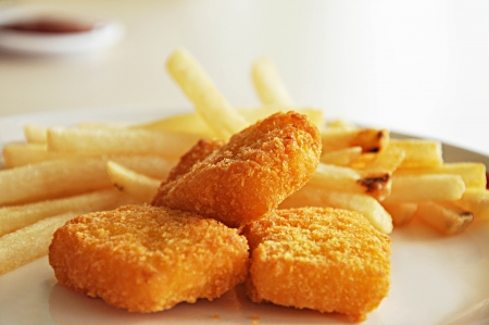 chicken nuggets: French fries and chicken nuggets