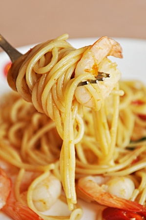 Fork with prawn pasta  - close up photo