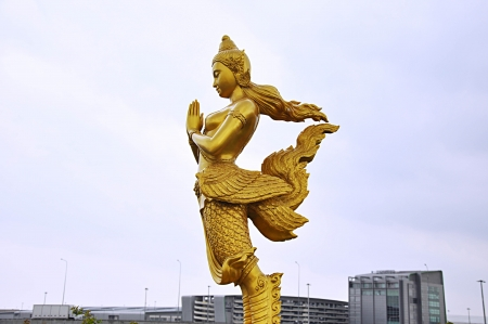 Thai style statue acting Wai  or Sawasdee  photo