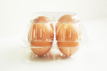 Four eggs in plastic package photo