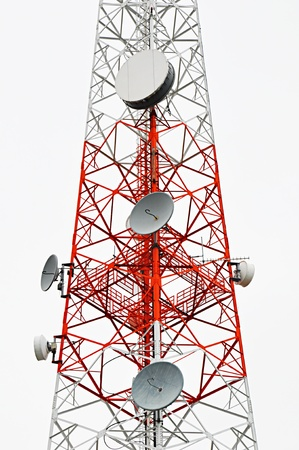 Red and white transmission tower photo