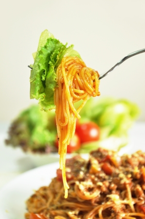 Spaghetti with meat and tomato sauce photo