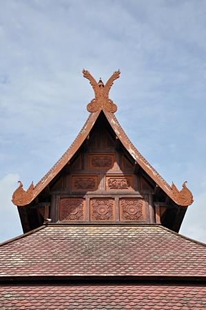 house gable: Gable end of ancient thai style pavilion Stock Photo