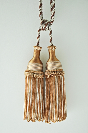 White and brown curtain tassels photo