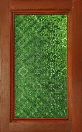 Ancient green glass and wooden window photo