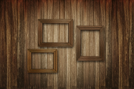 Three picture frames on old wood background photo