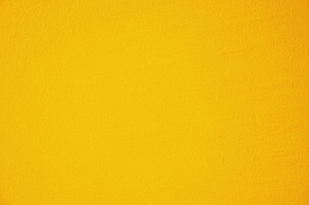 cement wall: Yellow concrete wall