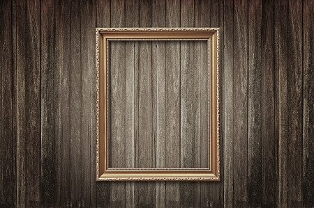 Picture frame on wood background photo