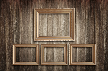 Four wooden photo frames on old wood background