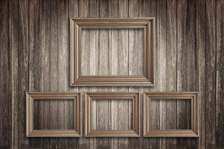 Four wooden picture frames on wood background photo