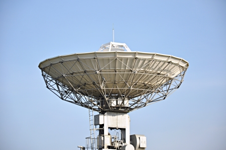 new media: A big satellite dish in blue sky background