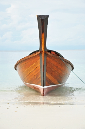 Long tail boat on the seashore at southern Thailand photo