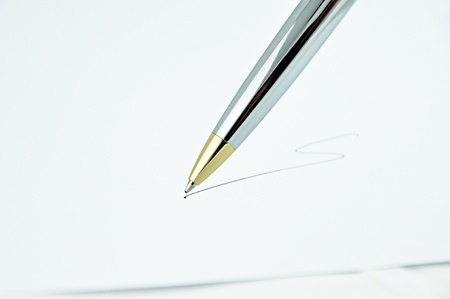 Pen writing a line on white paper photo