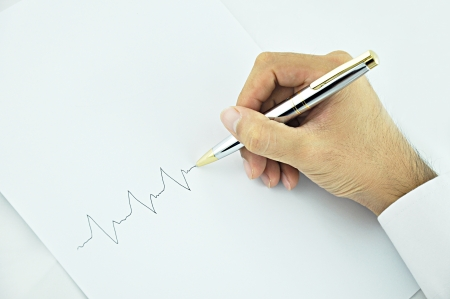 indentation: Doctor hand writing pulse line on white paper