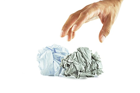 Hand reaching crumpled papers photo