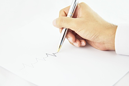indentation: Hand writing pulse line in white paper Stock Photo