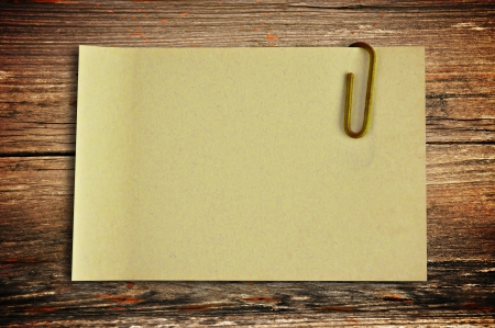 Note paper on old wood background photo
