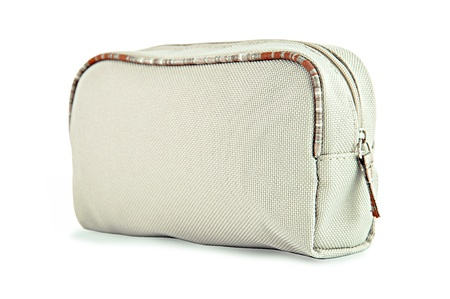 toiletries: Light brown fabric toiletry or cosmetic bag