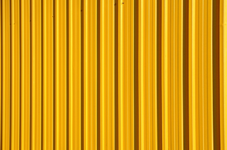 Yellow metal sheet wall background photo