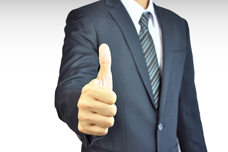 Businessman giving thumbs up - isolated on white background photo