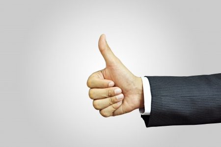 great suit: Businessman hand giving thumbs up sign - isolated on white background Stock Photo