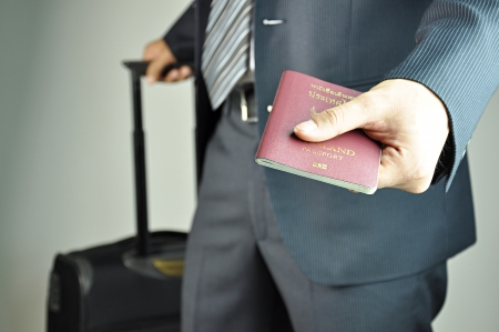 Traveling businessman handing passport photo