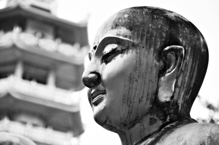god figure: Ancient Buddha face statue in Chinese temple