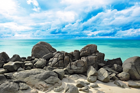 Rocks , sea and blue sky photo