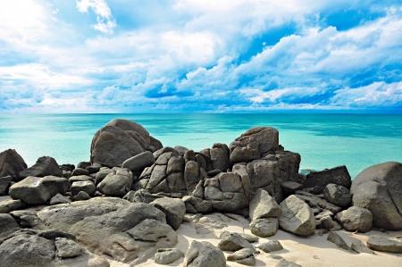 Rocks , sea and blue sky photo