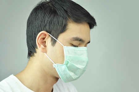 protective wear: Man wearing medical mask Stock Photo