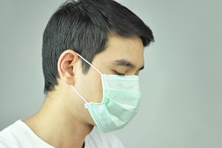 head wear: Man wearing medical mask Stock Photo